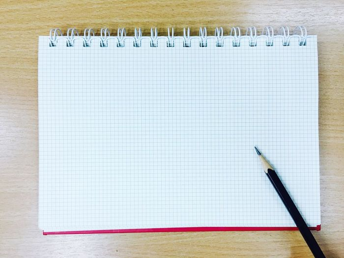 High angle view of pencil and paper on table