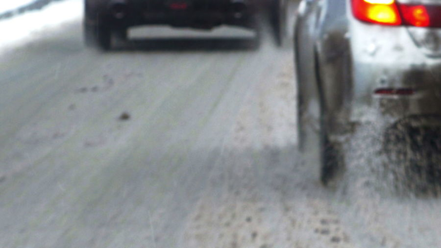 Close-up of wet car on street