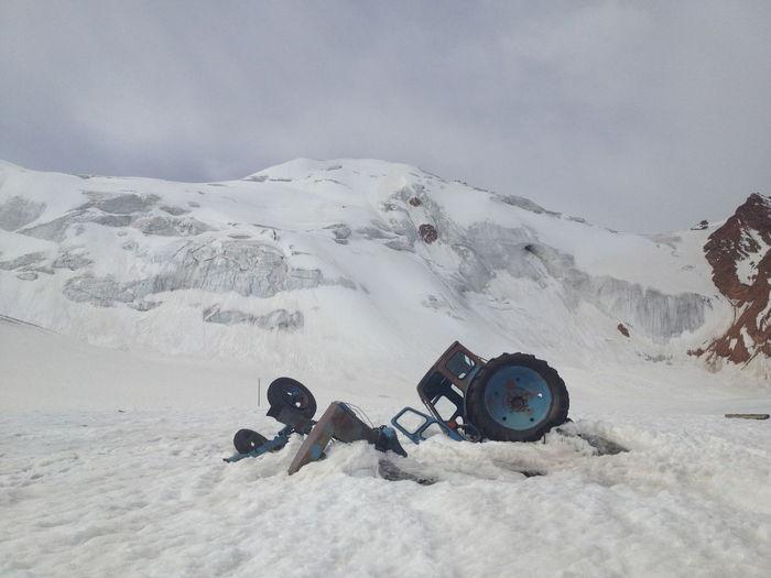 Abandoned vehicle on snow covered landscape