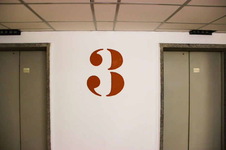 Architecture Art Is Everywhere Elevator Hallway Living Sign Architecture Building Close-up Communication Daily Life Day Door Hall Indoor Indoor Photography Indoors  Inside No People Number Numbers Symmetrical Symmetry Text Three