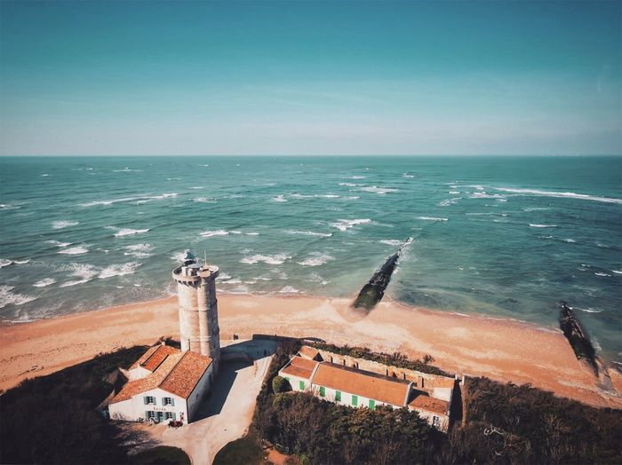 Phare ohé Sea Water Sky Horizon Horizon Over Water Beach Nature Land Scenics - Nature Wave Architecture Day High Angle View Built Structure Beauty In Nature No People Motion Building Exterior Sunlight Outdoors