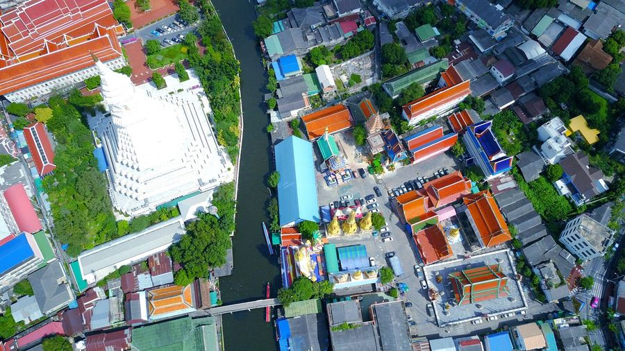 Tree City Architecture Building Exterior Multi Colored Outdoors Built Structure Growth Green Color No People Day Cityscape Nature Sky Temple - Building Pagodas Pagoda Temple Canals And Waterways Canal Transportation Water Transportation Low Angle View Thailand Photos Urban Skyline Travel Destinations Flying High The Architect - 2017 EyeEm Awards The Street Photographer - 2017 EyeEm Awards The Great Outdoors - 2017 EyeEm Awards