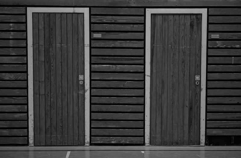 Closed wooden door of building