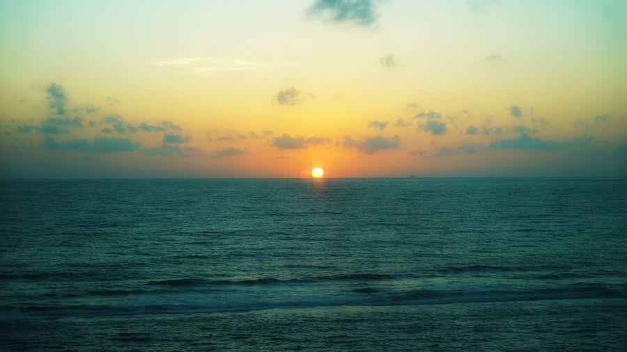 Sky Sea Water Horizon Over Water Horizon Scenics - Nature Beauty In Nature Sunset Tranquil Scene Tranquility Waterfront Orange Color Sun Cloud - Sky Idyllic Nature No People Non-urban Scene Remote Outdoors