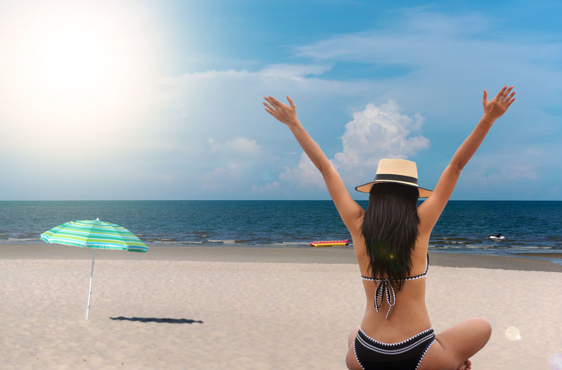 Sea Sky Water Beach Land Horizon Over Water Real People Hat Horizon Rear View One Person Leisure Activity Lifestyles Clothing Nature Beauty In Nature Women Cloud - Sky Scenics - Nature Hair Outdoors Hairstyle Human Arm Arms Raised