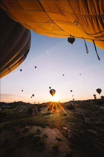 Sunset Hot Air Balloon Flying Adventure Outdoors Ballooning Festival Sky Nature Travel Turkey Moody Sky First Eyeem Photo End Of The Day Love EyeEmNewHere Let's Go. Together.