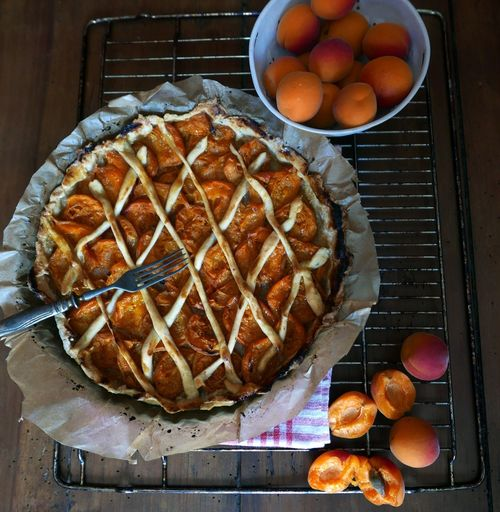 Close-Up Of Fork On Baked Apricot Tart