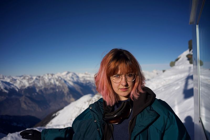 Young Adult Young Women Winter Snow Cold Temperature One Person Mountain Leisure Activity Real People Warm Clothing Lifestyles Sky Portrait Headshot Mountain Range Women Outdoors Clothing Scenics - Nature Snowcapped Mountain