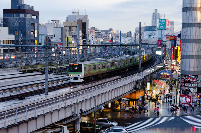 JR Train Japan Tokyo Architecture Building Exterior Built Structure City City Life Day High Angle View Mode Of Transport No People Outdoors Public Transportation Rail Transportation Railroad Track Sky Skyscraper Train Train - Vehicle Transportation Fresh On Market 2017