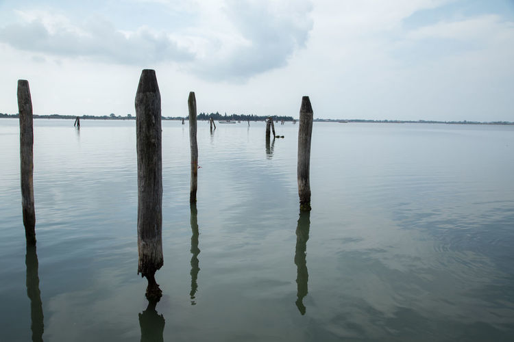 In the Lagoon Day Horizon Over Water Reflection Scenics Sky Tranquility Travel Destinations Travel Photography Water Wooden Post