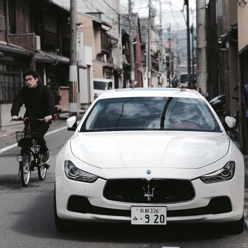 Car Transportation Ghetto Contrast Mode Of Transport Land Vehicle Architecture Outdoors Built Structure City Men One Person People Cheerful