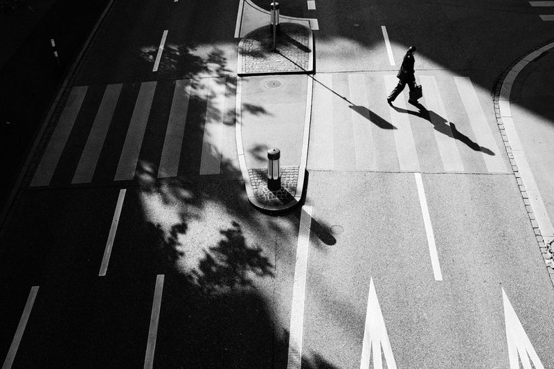 High Angle View Of Woman Crossing Street In City