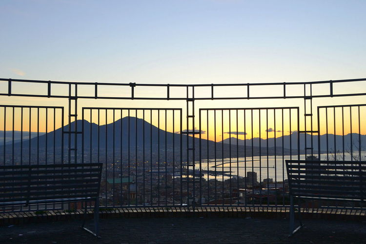 Colors Morning Morning Light Naples Vesuvio View Architecture Bridge - Man Made Structure Building Exterior Built Structure Clear Sky Day Italy Nature No People Outdoors Placetovisit Prison Railing Sky Sunset Sunshine Travel Destinations Vesuviocoast Water