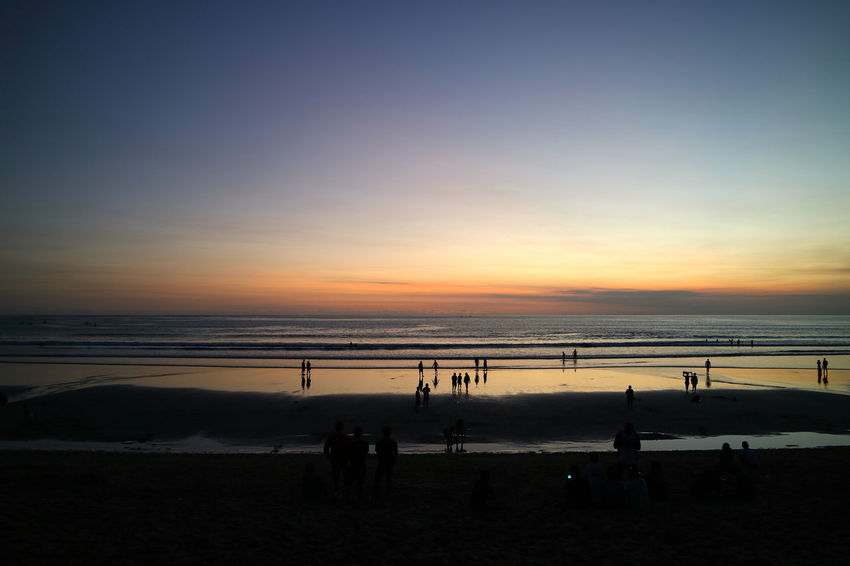 Kuta Beach Denpasar. Bali. Indonesia Beach Beach Volleyball Beauty In Nature Enjoyment Horizon Over Water Leisure Activity Lifestyles Medium Group Of People Nature Net - Sports Equipment Outdoors Playing Real People Sand Scenics Sea Shore Silhouette Sky Sunset Tranquil Scene Tranquility Vacations Water Weekend Activities