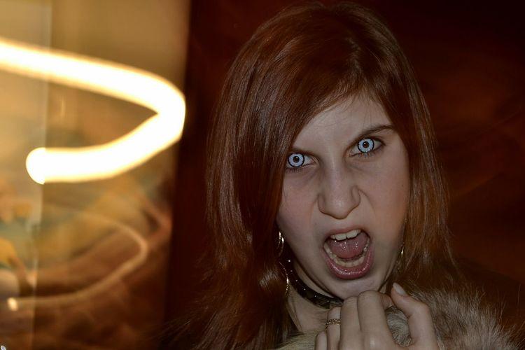 Portrait of woman wearing screaming