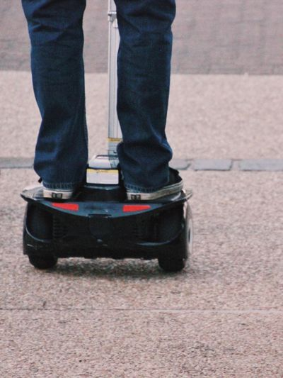 Close-up, rear view of Segway ride Person Low Section Standing Men Shoe Rear View Human Foot Selective Focus Enjoyment Day Well-dressed Outdoors Transportation Lifestyles Segway Streetphotography City Life Street Pavement EyeEmAustralia Australia Transport People And Places