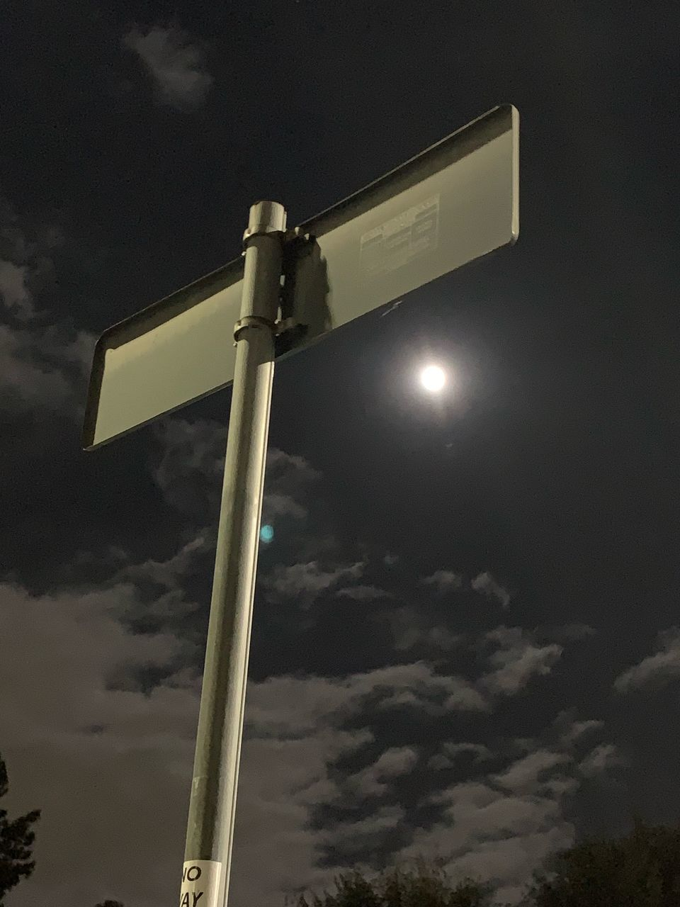 low angle view, sky, cloud - sky, no people, pole, lighting equipment, nature, outdoors, street, illuminated, night, technology, street light, electricity, sign, surveillance, communication, dusk, security