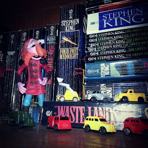 Not sure if it's a good idea to put all these tiny toy vehicles on the same shelf as the Stephen King books... Toys Toy Car Books Shelf My Stuff Stephen King Creepy Floyd Pepper Open Edit