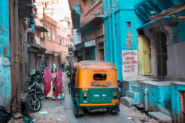 Taken on the streets of Jodhpur. The Street Photographer - 2018 EyeEm Awards Architecture Building Building Exterior Built Structure City City Life Day Full Length Incidental People Jinrikisha Land Vehicle Mode Of Transportation Outdoors People Public Transportation Rickshaw Road Street Transportation Travel