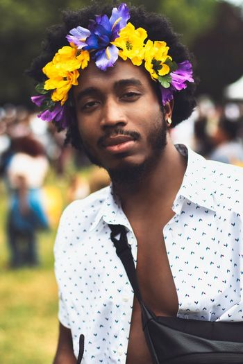 Curlfest 2018 Flower Flowering Plant Plant Young Adult Lifestyles One Person Portrait Focus On Foreground Real People Nature Beauty Standing Casual Clothing Outdoors Adult Front View Leisure Activity The Portraitist - 2018 EyeEm Awards