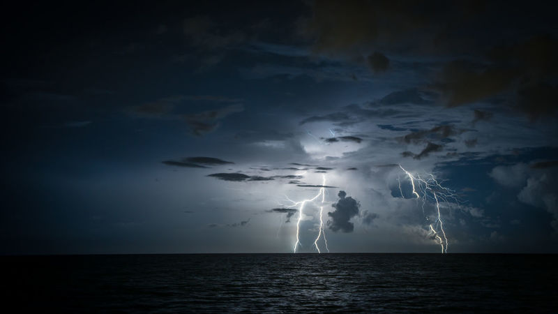 Lightning from storm over the Atlantic Ocean. Beauty In Nature Cloud - Sky Forked Lightning Horizon Over Water Lightning Nature Night No People Ocean Outdoors Scenics Sea Sky Thunderstorm Tranquil Scene Tranquility Water Waterfront