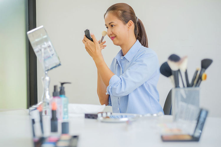 Adult Beautiful Woman Business Business Person Females Hairstyle Indoors  Occupation Office One Person Real People Side View Sitting Standing Table Technology Waist Up Women Working Young Adult Young Women