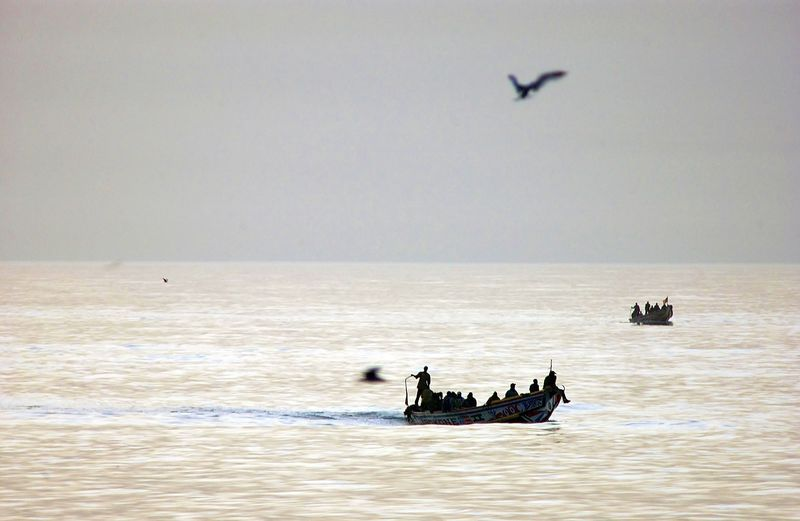 Fishing canoe on the ocean returning to port in cap skirring casamance south of senegal
