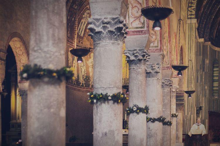 Wreaths decorated around columns in church