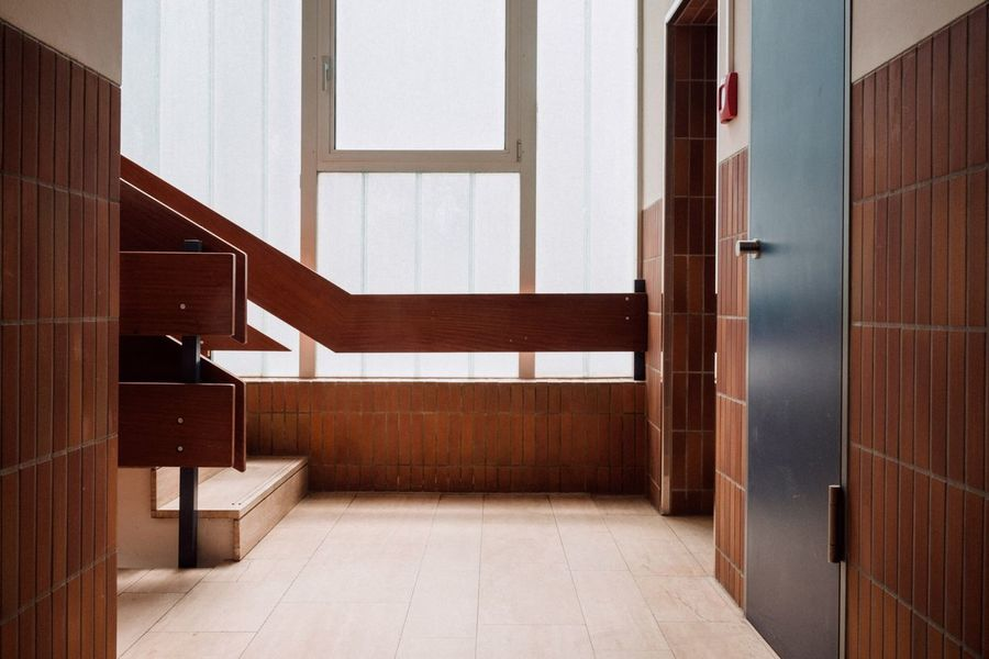 Symmetry Brown Architecture Indoors  Entrance Built Structure Door Building No People Tile Day Absence Safety Staircase Modern Arcade Luxury Flooring