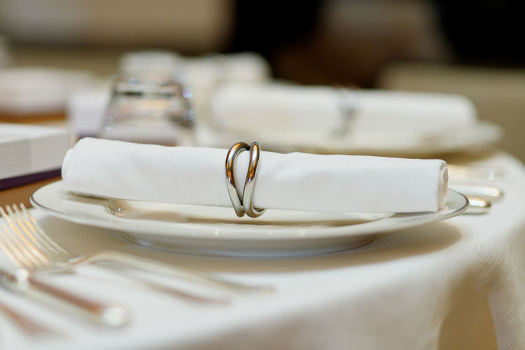 Restaurant table details Table Wedding Place Setting Setting Food And Drink Plate Event Indoors  No People Celebration Still Life Household Equipment White Color Restaurant Selective Focus Life Events Wealth Fork Luxury Furniture Wedding Ceremony Dining Table Knife Empty Plate Glass