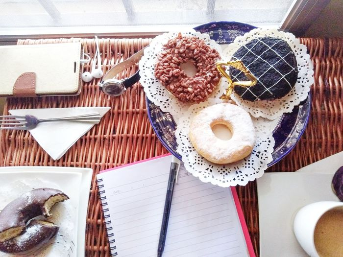 Relaxing tea-time. Happiness Sweet Food Writing Relaxing Relaxing Moments Donuts Doughnuts Teatime Coffee Time EyeEm Selects PhonePhotography Table Tablecloth Plate Directly Above High Angle View Coffee - Drink Close-up Food And Drink Coffee EyeEmNewHere