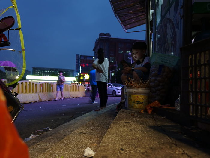 People on road at night