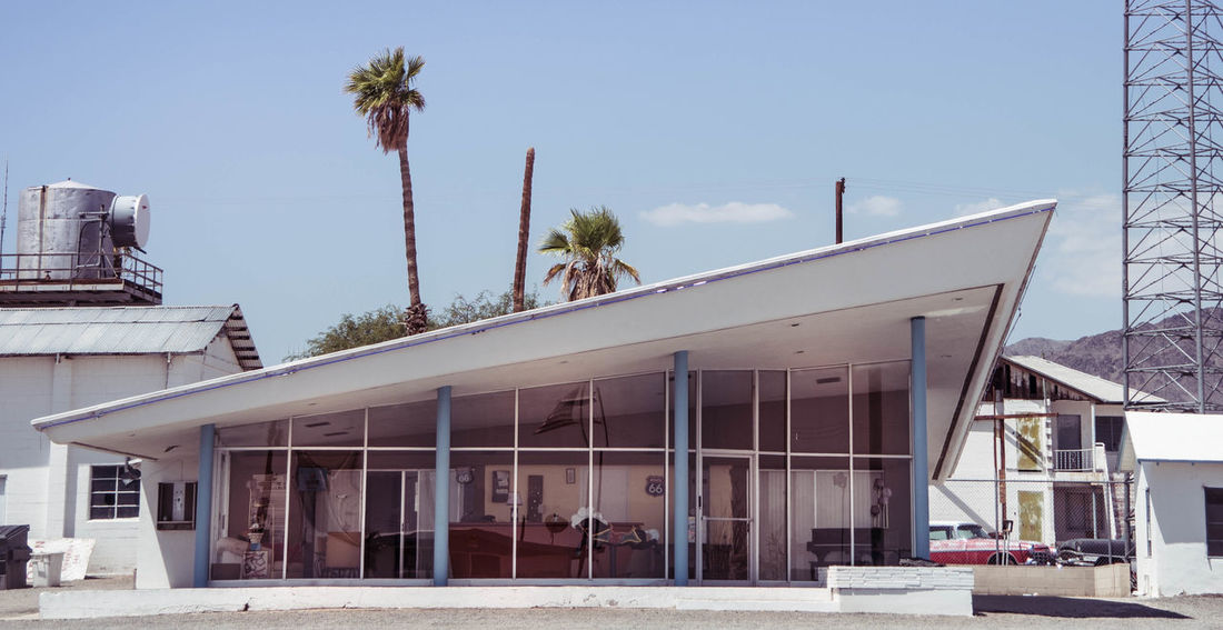 California Route 66 Architecture Building Building Exterior Built Structure City Clear Sky Day Growth House Mid Century Architecture Nature No People Outdoors Palm Tree Plant Residential District Sky Sunlight Tree Tropical Climate Window