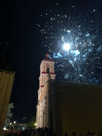 Parrandas de Remedios Architecture Astronomy Building Exterior Built Structure Celebration Clock Tower Firework - Man Made Object Firework Display Illuminated Low Angle View Midnight Motion Night No People Outdoors Place Of Worship Religion Sky Star - Space Travel Destinations Tree