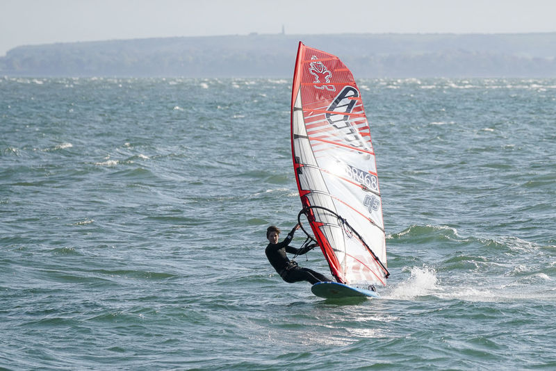 Windsurfers racing off Hayling Island sea front in Hampshire, UK. England English Channel Europe GYBE Gybing Hampshire  Hants Hayling Island  Racing Sail Sailboard Sailboarding Sailing Slalom Slalomboard Slalomtraining Speed Uk Windsurf Windsurf Life Windsurfen Windsurfer Windsurfers Windsurfing Windy