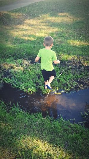 Childhood Water Children Only Outdoors Grass Nature Check This Out Milenamulskephotography Green Grass Nature Playing In The Water Boys Will Be Boys Creek Small Creek Muddy Waters Stuck In The Mud Montana Beauty Playing Outdoors
