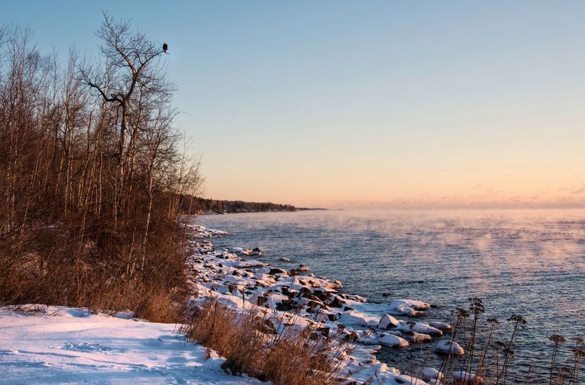 Fishing at sunrise is the best! Tranquility Nature Beauty In Nature Cold Temperature Tranquil Scene Bare Tree Scenics Sunset Water Winter Sky Outdoors No People Frozen Sea Snow Day Malephotographerofthemonth Lakesuperior