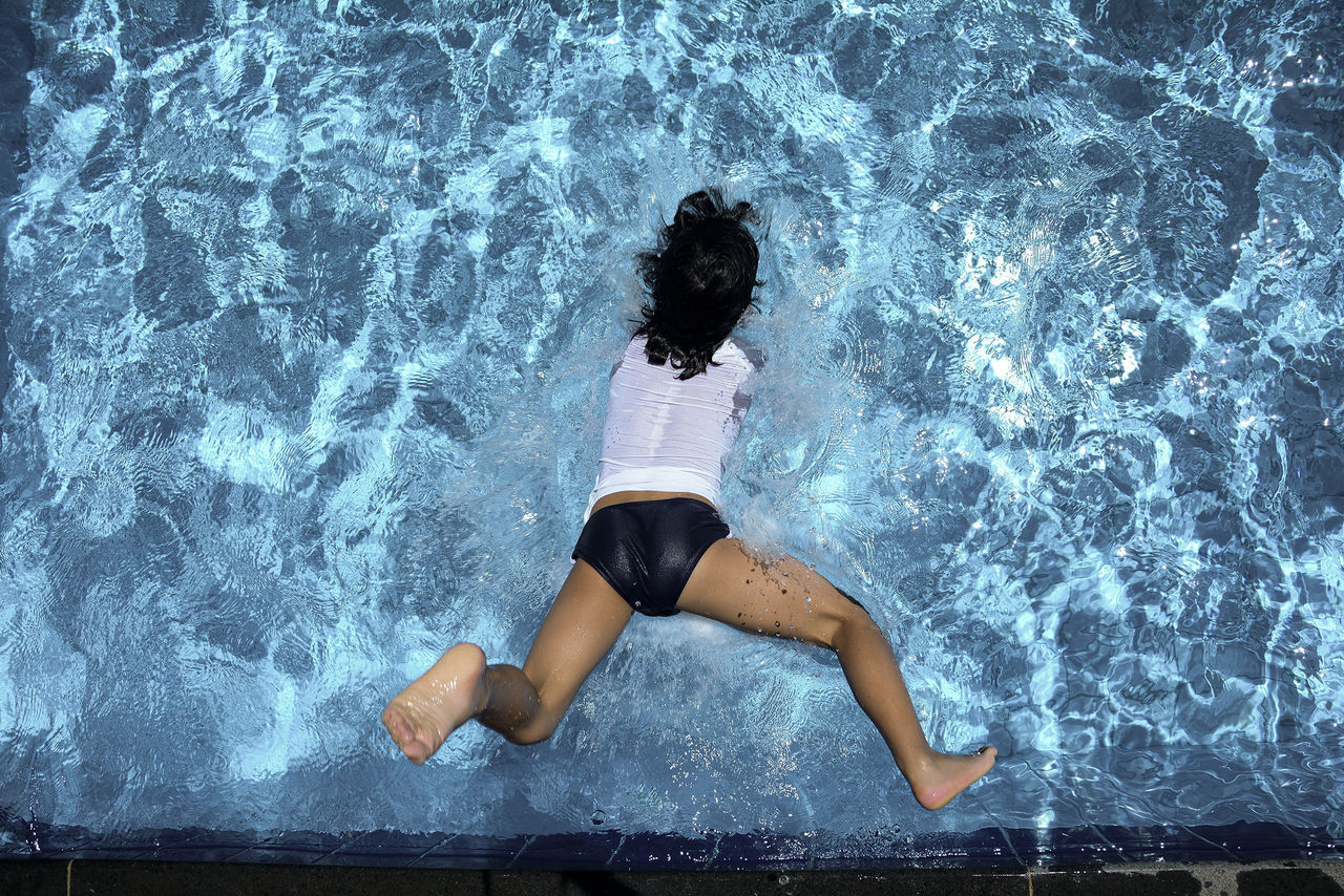 High angle view of woman diving into water
