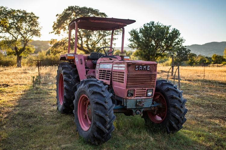 Old Tractor on a field during sunset Tractor Agriculture Evening Farm Grass Italy Land Vehicle Old-fashioned Rural Scene Same  Sardegna Sardinia Sunset Transportation