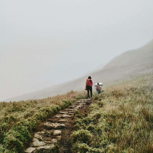 Don't stop, keep walking Healthy Lifestyle Outdoors Walking Nature Fog Cold Temperature Warm Clothing Foggy Landscape Travel Destinations Young Adult Phone Photography Mountain Range Hiking Foggy Mountain Tranquility Landscape Beauty In Nature Travel Adventure
