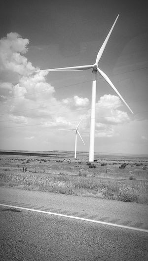 Wind Power Wind Turbine Environmental Conservation Alternative Energy Rural Scene Outdoors Landscape No People Cloud - Sky Road