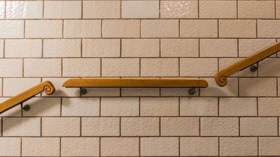 Close-up of padlock hanging on metal wall