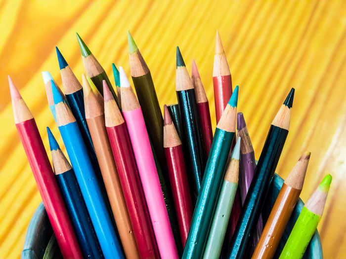 Multicolored pencils are combined in a steel box on a desk in the office. Art Background Blue Bright Brown Closeup College Color Colored Colorful Colors Colour Concept Crayon Crayons Creative Design Draw Drawing Education Equipment Frame Green Group Image Isolated Macro Object Office Orange Paint Palette Pen Pencil Pencils Rainbow Red Row School Set Sharp Stationery Supplies Up Variation Vector White Wood Wooden Yellow Multi Colored Choice Writing Instrument Large Group Of Objects Art And Craft Colored Pencil Close-up No People Craft Still Life Creativity Indoors  Vibrant Color Studio Shot Art And Craft Equipment Group Of Objects Wood - Material Variety