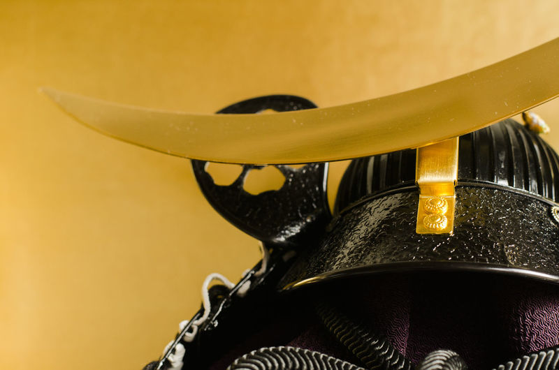 Traditional Japanese Kabuto display. Children's Day Gold Kabuto Black Color Boys Day Close-up Colored Background Drop Focus On Foreground Gold Colored Indoors  Kodomonohi Metal Nature No People Samurai Security Selective Focus Single Object Still Life Studio Shot Water Yellow