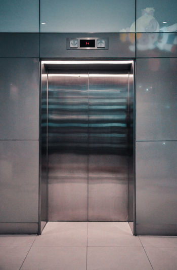 Architecture Built Structure Closed Door Elevator Entrance Flooring Illuminated Indoors  Metal Modern No People Silver Colored Steel Technology Wall - Building Feature