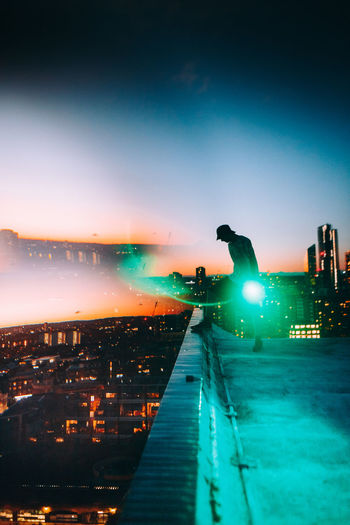 Colors Exploring Green Light London Odeon Rooftop Silhouette Adventure Architecture Building Building Exterior Built Structure City Cityscape Illuminated Landscape Nature Night One Person Orange Color Outdoors Sky Sunset Surrealism Adventures In The City The Creative - 2018 EyeEm Awards