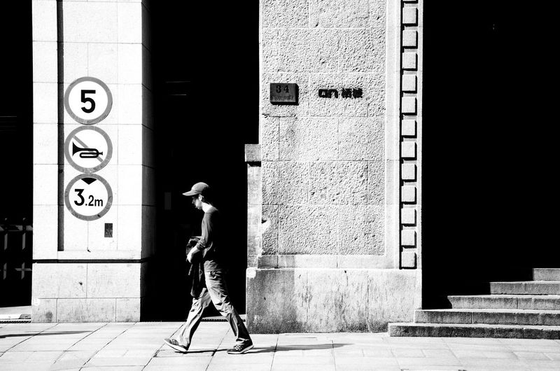 Door Outdoors Sculpture One Man Only City Architecture Full Length Street Art Building Exterior Adult People One Person Only Men Built Structure Day City Black And White Photography Black And White Collection