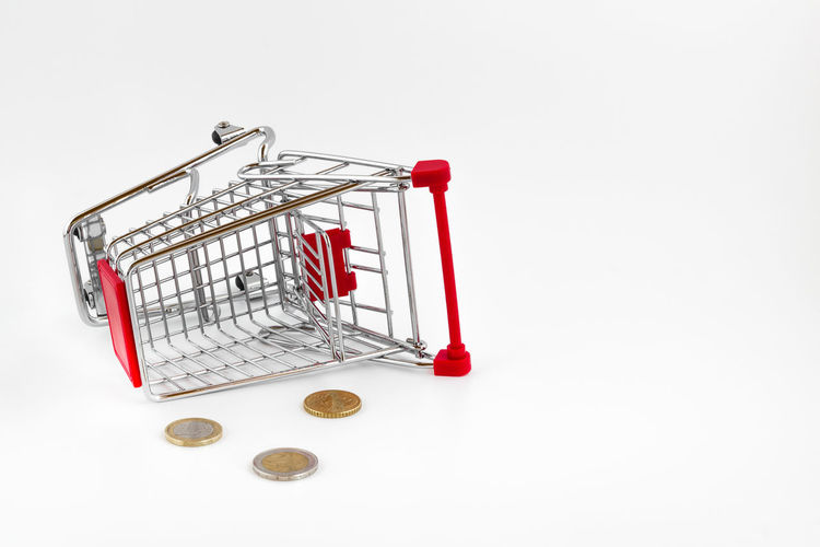Empty shopping cart. Conceptual representation of a failure, of poverty and being broke. Accident Banknotes Bankrupt Broke Cart Commercial Consumerism Crash Crisis Discount Down Economy Empty Euro Failure  Falling Financial Loss Poor  Poverty Retail  Sale Shop Shopping Supermarket