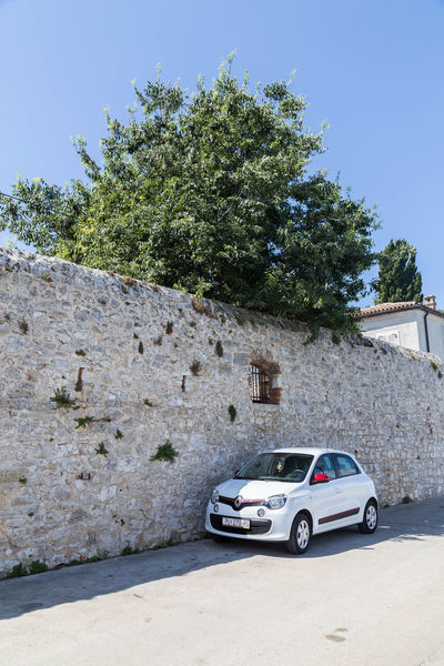 Parked in the shade... Croatia Porec, Croatia Shade Shady Spot Travel Travel Photography Wall Architecture Blue Sky Car Croatian Town Day Little Car  No People Outdoors Parked Parked Car Parked In The Shade Porec Shady Place Shady Trees Sky Transportation Tree White Car