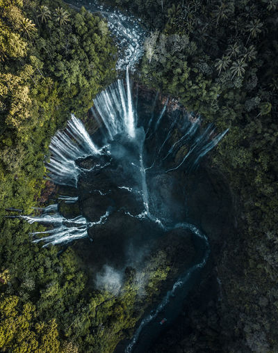 Drone view of water flowing through mountains